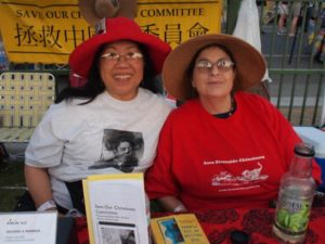 Judy Lee and SOCC Board member Dr. Margie Akin model new SOCC t-shirts at the booth during the Fourth of July Founder's Day event. 2012.