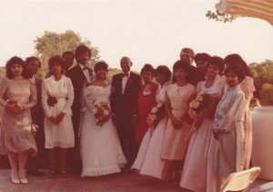 Group photo of people standing at a wedding.