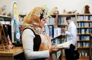 Image of Ariana Hussain and Imad Hussain at a children's library.